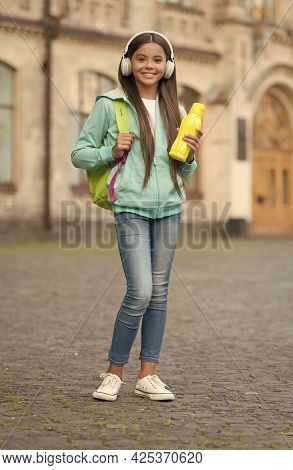 Teen Girl With Juice Or Water Bottle In Headphones Care Health And Body Hydration, Water Balance