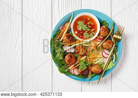 Vietnamese Banh Mi Salad With Pork Meatballs, Carrot, Cucumber, And Radish Served Over Romaine Lettu
