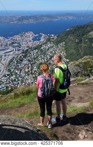 Bergen, Norway - July 23, 2020: People Hike Ulriken Mountain Trail Overlooking City Of Bergen, Norwa