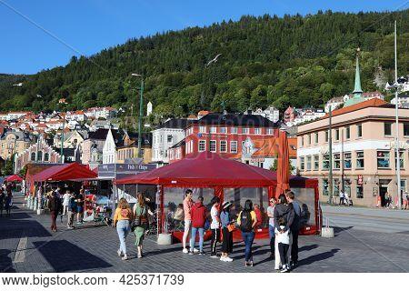 Bergen, Norway - July 23, 2020: People Visit Fish Market In Bryggen District Of Bergen, Norway. It I