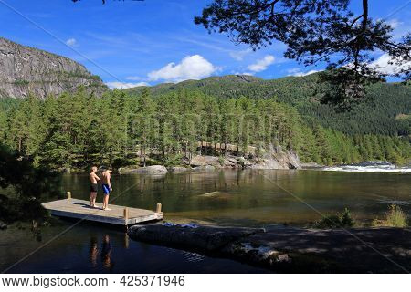 Setesdal, Norway - July 31, 2020: People Visit Swimming Area Of River Otra In Setesdal Valley, Norwa