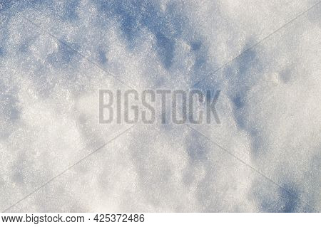 Fresh Clean White Snow Background Texture. Winter Background With Frozen Snowflakes And Snow Mounds.