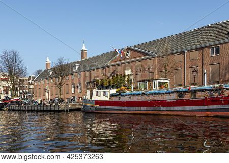 Amsterdam, Netherlands -12 March 2016: Barge Moored On The Canal In Front Of Hermitage Amsterdam. Du
