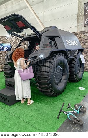 Wheeled All-terrain Vehicle. Visitors Watch The Nomad All-terrain Vehicle At Arms And Security - 202