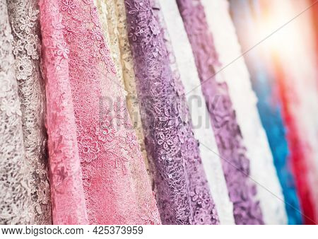 Colorful Fabric Lace Fabric Rolls In Textile Shop Industry. Rolls Of Bright Colored Fabric