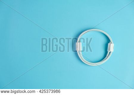 Cable With Usb Type C And Lightening On The Blue Background With Copy Space.