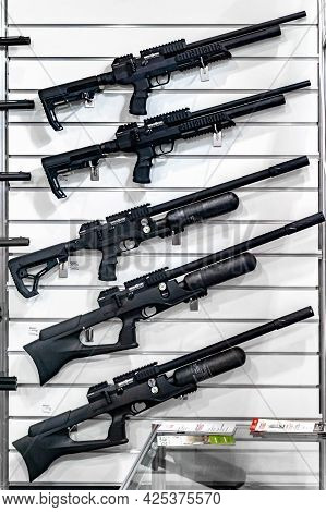 Pump Action Shotguns. Stand With Weapons At The International Exhibition Arms And Security - 2021. S