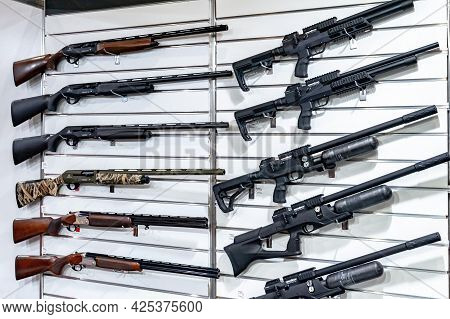 Hunting And Pump Action Guns. Stand With Hunting And Pump Action Weapons At The International Exhibi