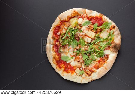 Pizza With Smoked Ham And Rucola On Black Background. Tasty Thin Italian Pizza With Meat On Dark Gro