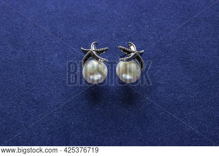 Pair Of Gold Earring With Pink Pearl Isolated On White
