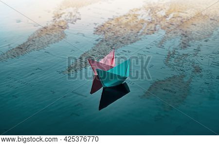 Two Paper Boats Of Pink And Blue Color, Float On The Water. Under The Water You Can See A Map Of The