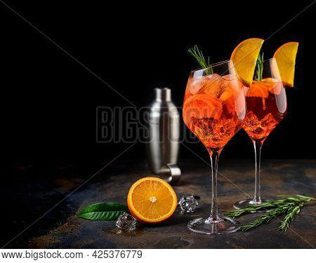 Wineglass Of Ice Cold Aperol Spritz Cocktail Served In A Wine Glass, Decorated With Slices Of Orange
