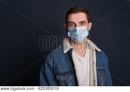 Portrait Of A Tired Young Man Wearing A Whiteportrait Of A Young Man Wearing Jeans Jacket In A White