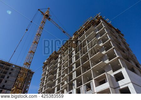 Construction Crane At A Construction Site. Mechanisms For Lifting Construction Materials. Lifting Co