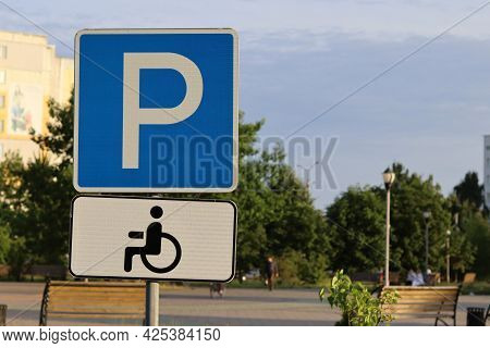 Parking For The Disabled - A Road Sign With A Symbol Of Parking For People With Disabilities, Wheelc