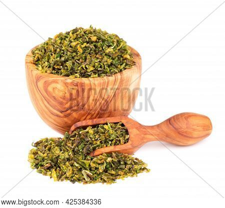 Dried Green Paprika Flakes With Seeds In Olive Bowl And Scoop, Isolated On White Background. Chopped