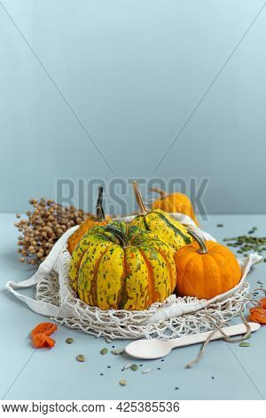 Zero Waste Healthy Food Pumpkin, Seeds, Vegetables, Dried Fruits Close Up On Blue Background. Grocer