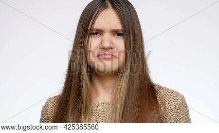 Portrait Of Teenage Girl Disagree And Saying Ni With Shaking Head