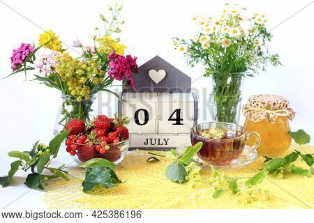 Calendar For July 4 : The Name Of The Month Of July In English, Cubes With The Numbers 0 And 4 , Bou