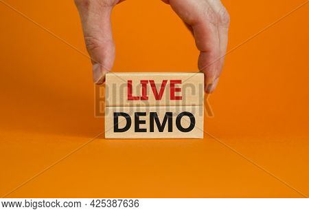 Live Demo Symbol. Concept Words 'live Demo' On Wooden Blocks On A Beautiful Orange Background. Busin