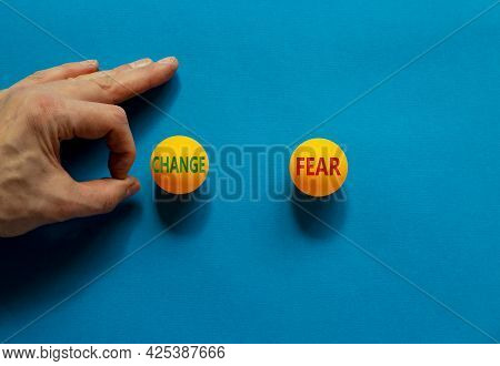 Fear Vs Change Symbol. Male Hand Is About To Flick The Ball. Orange Table Tennis Balls With Words Fe