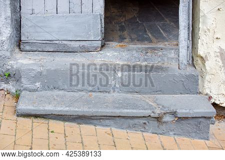 Concrete Steps Entrance To The Old House With A Wooden Door Threshold Of The Building On The Descent