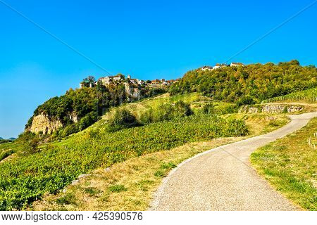 Chateau-chalon Village Above Its Vineyards In Franche-comte, France