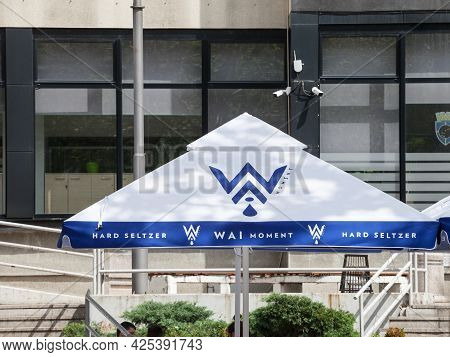 Belgrade, Serbia - May 29, 2021: Logo Of Wai Moment On The Umbrella Of A Belgrade Retailer. Wai Mome
