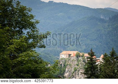 Selective Blur On The Bled Castle, Also Called Blejski Hrad, During Summer, Surrounded By The Trees