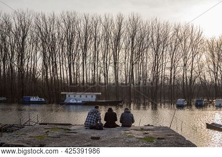 Pancevo, Serbia - February 27, 2016: Young People, Teenagers, Serbian Youth, Sitting In Front Of The