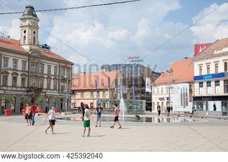 Osijek, Croatia - May 12, 2018: Children Playing Football On Trg Ante Starcevica Square, The Main Pe