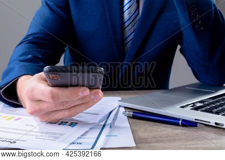 Midsection of caucasian businessman using smartphone, isolated on grey background. business technology, communication and growth concept digitally generated composite image.