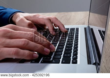 Midsection of caucasian businessman typing on keyboard, isolated on grey background. business technology, communication and growth concept digitally generated composite image.