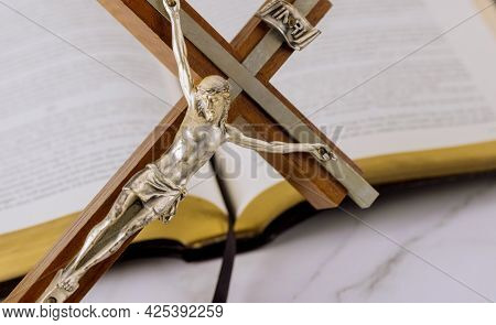 Jesus On Way To God Through Prayer Holy Bible And The Crucifix Of The Christian Cross The Hope Of Ma