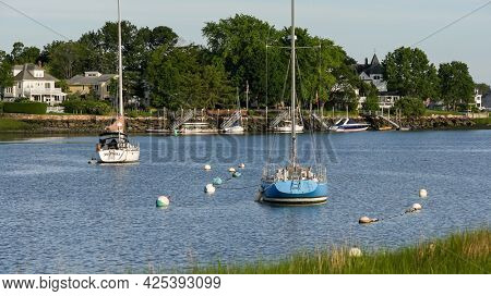 NORWALK, CT, USA - JUNE, 25, 2021: Evening lights on boats and view from Veterans Memorial Park and Marina