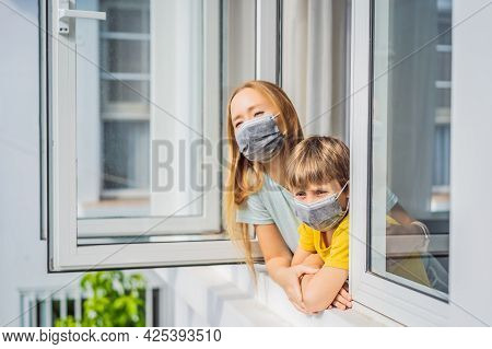Extremly Tired Mother And Son Looking Out The Window, Home Alone. Self-isolation At Home, Quarantine