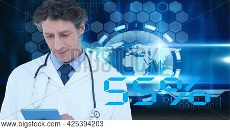 Male senior doctor using digital tablet against globe and data processing on blue background. medical research and science technology concept