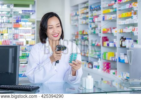 Pharmacist Scanning Barcode Of Medicine Drug In A Pharmacy Drugstore. Health Care And Medical Concep