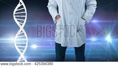 Mid section of male doctor against dna structure and spots of light on blue background. medical research and science technology concept