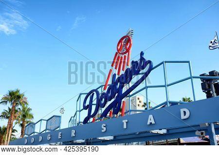 LOS ANGELES, CALIFORNIA, 29 JUNE 2021:  Dodger Stadium. Closeup of the baseballs teams logo at the Centerfied entrance.