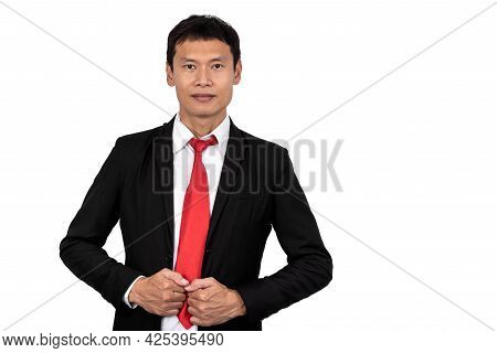 Portrait Image Of Asian Business Man Wearing Black Suit Standing And Smile On White Isolated Backgro