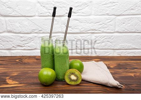 Fresh Green Smoothie On Rustic Wooden Background. Colourful Healthy Green Smoothies. Glasses With Gr