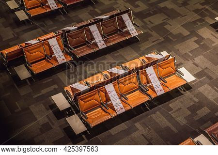 31.05.2021, Doha, Qatar: Socia Distancing Sign At Airport Seat, New Normal Concept. Deserted Airport