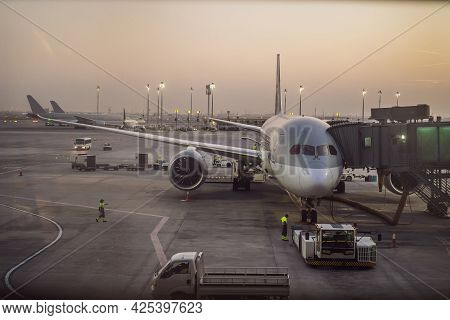 The Aircraft Is Attached To The Terminal Gangway Of The Airport Building While Refueling Before The