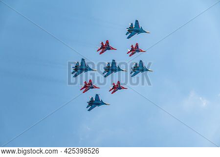 Moscow, Russia - May, 05, 2021: Diamond-shape Of 4 Mig-29 The Russian Knights And 5 Su-27 Swifts In