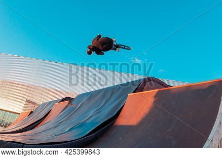 Bmx Rider Doing Trick On Ramp In Skate Park. Sports, Extreme Sports, Freestyle, The Concept Of Outdo