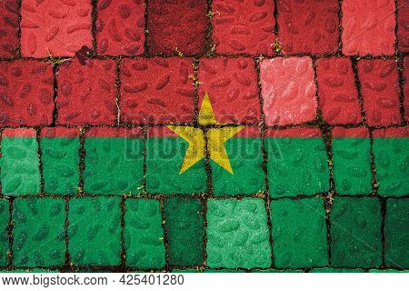 National Flag Of Burkino Faso On Stone  Wall Background. Flag  Banner On  Stone Texture Background.
