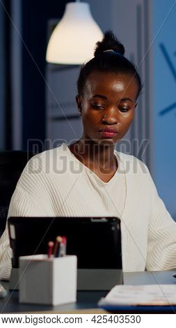 Multitasking Black Business Woman Working At Laptop And Tablet In Same Time Doing Overtime In Start-