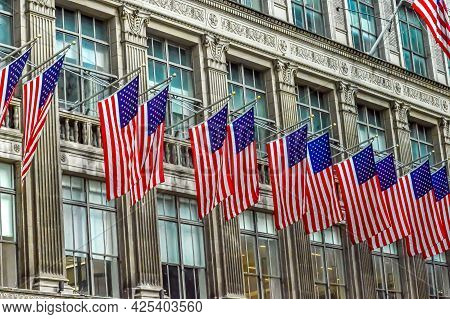 The Saks Fifth Avenue, American Department Store Decorated With Usa Flags In Midtown Manhattan In Ny