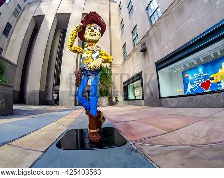 Life Size Woody Toy Model, Made Out Of Legos, Tilting His Hat At You, And Crossing His Leg Standing